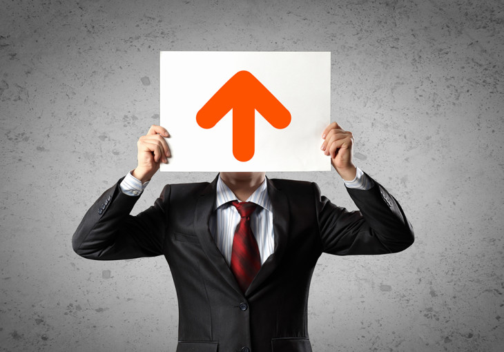 Image of man holding board with arrow picture